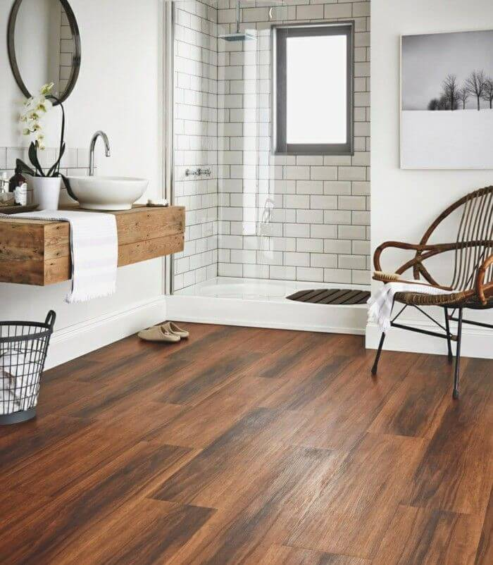 Change the ceramic floor to a wooden floor to give a rustic touch to your minimalist bathroom