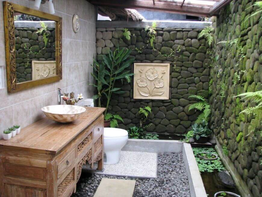 Natural stone walls and ornamental plants placed in the bathroom